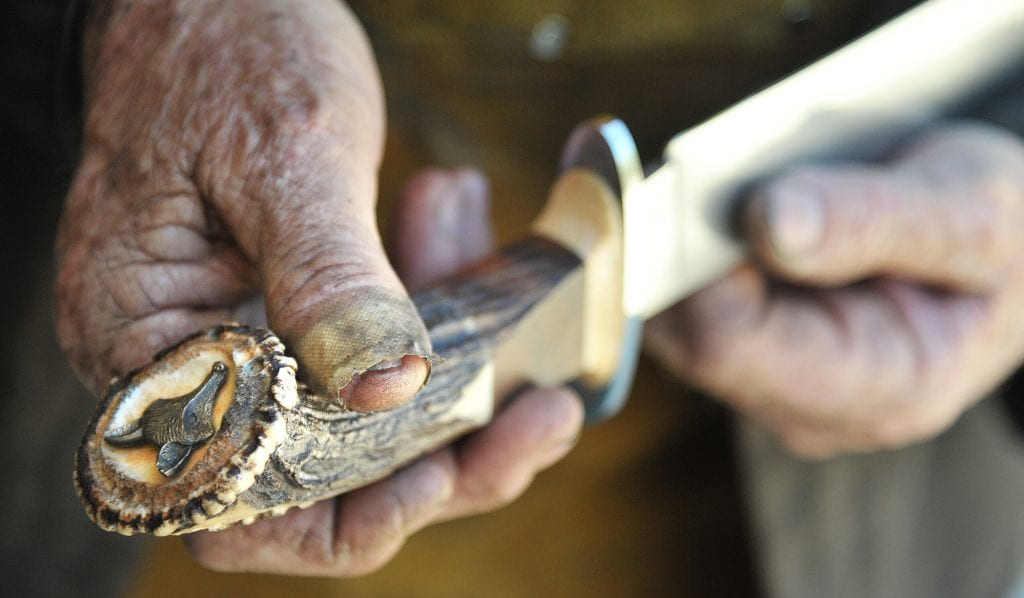 A fox head decoration is displayed on the Indian stage handle of the custom bowie knife. Dan Watson