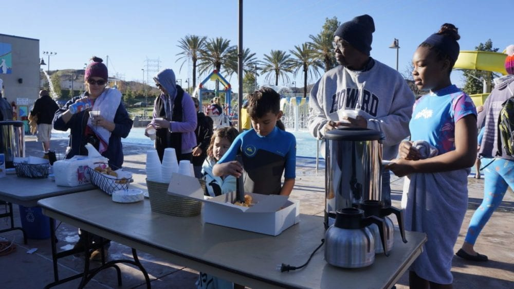 Participants of the annual Arctic Chill Polar Bear Swim warm up with hot cocoa and coffee at the Santa Clarita Aquatic Center on Sunday. Samie Gebers/ Signal