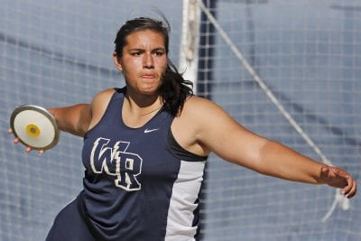 Track and field athletes poised to perform in shot put and discus at Masters Meet