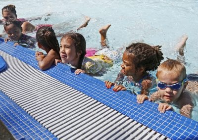 Children make a splash at World's Largest Swim Lesson