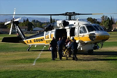 Football player air lifted to hospital after head injury