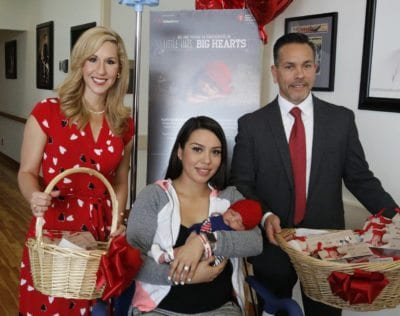 Newborns at Henry Mayo receiving red hats for Heart Month