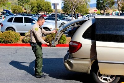 Woman detained amid license plate investigation