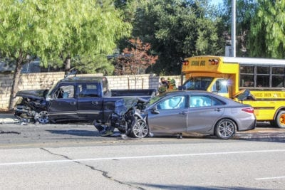 One adult hurt in 3-vehicle crash involving school bus