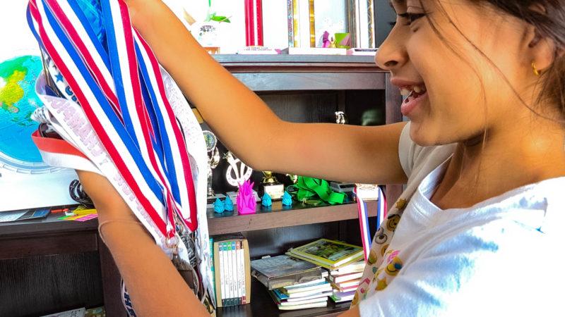 7-year-old Aakashi Ahuja displays her awards. Lorena Mejia/The Signal