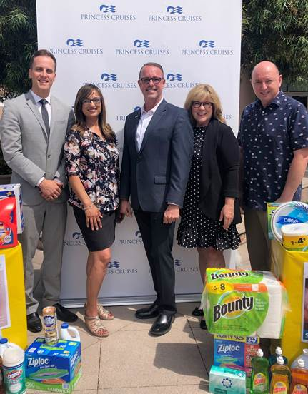 Left to right: Family Promise vice president Jerrid McKenna, Princess Cruises programs and events specialist Paula Triggs, Princess Cruises vice president of bBrand and corporate communications Brian O'Connor, Family Promise former president Laurie Ender, and Family Promise executive director Roche Vermaak gather as Princess Cruises makes a donation to Family Promise as part of their Summer Sizzle Series of community outreach. Courtesy of Alivia Owyoung