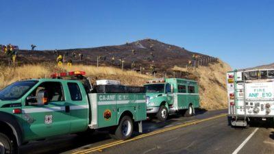 Strong winds whip up spot fire inside Tick Fire zone