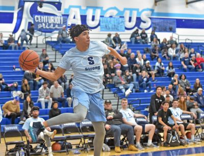 Cents come together to support school in alumni basketball game
