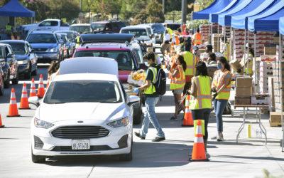 Drive-thru food distribution draws long line, plenty of gratitude