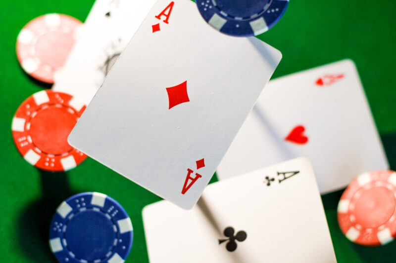 playing cards and poker chips falling down