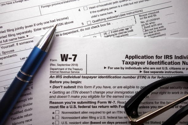 W-7 irs federal tax form closeup W-7 irs federal tax form closeup, finance concept itin tax stock pictures, royalty-free photos & images